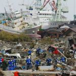 Soldiers of Japan Self-Defense Force and firefighters search for the victims in the rubbles