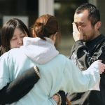 A man cries after learning his friend was killed in the earthquake