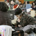 People taking rest at an evacuation center in Kamaishi, Iwate prefecture