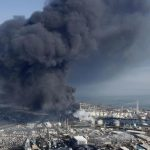 Black smoke rises from an industrial complex in Shiogama, Miyagi prefecture