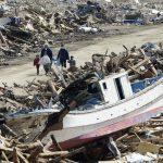Residents walk through debris in Minami Sanriku, Miyagi