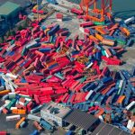 Container cargoes scattered like toy blocks on the ground in an industrial complex in Sendai