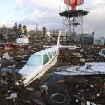 Neighbours - A plane and vehicles are submerged in debrls washed away by tsunami in Natori city