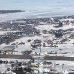 Buildings are submerged after an earthquake-triggered tsunami hit Yamamoto town in Miyagi prefecture