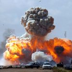 Vehicles belonging to forces loyal to Col. Qaddafi were bombed during an airstrike