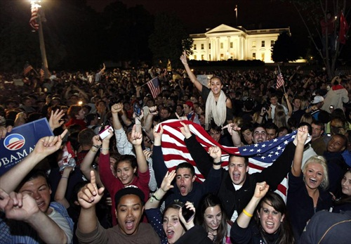 Washington DC - Crowds celebrate, chanting, and waving American flags