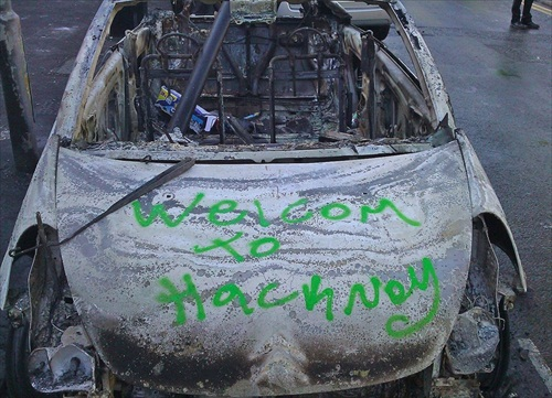 London-Riot-the-a-burned-out-car-on-clarence-road-in-hackney