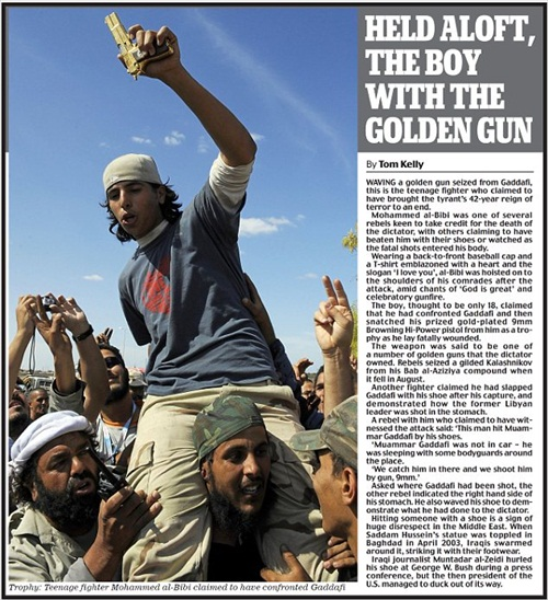 Boy with Gaddafi Golden Gun