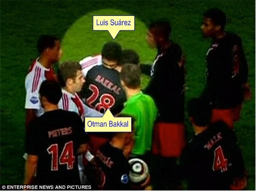 Uruguay Luis Suárez Bites PSV Eindhoven's Otman Bakkal