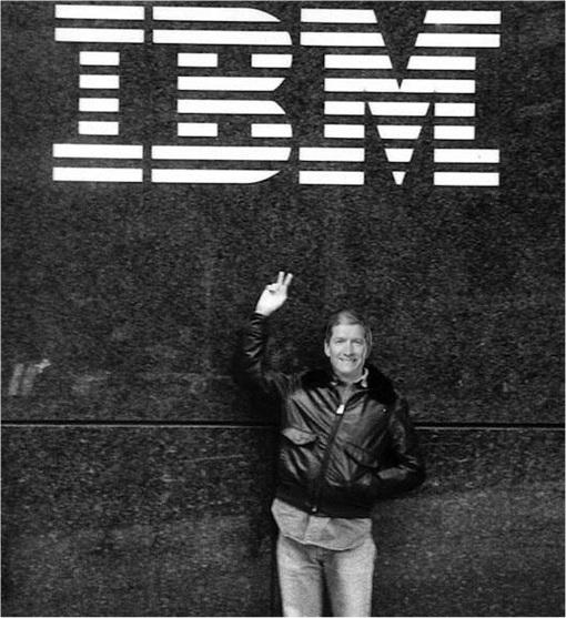 Apple and IBM Partnership - CEO Tim Cook under IBM Logo