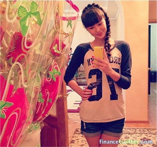 Kazakhstan Sabina Altynbekova - Volleyball Player Babe - checking phone casually at home