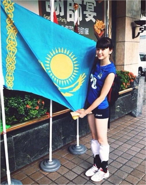 Kazakhstan Sabina Altynbekova - Volleyball Player Babe - standing with Kazakhstan flag