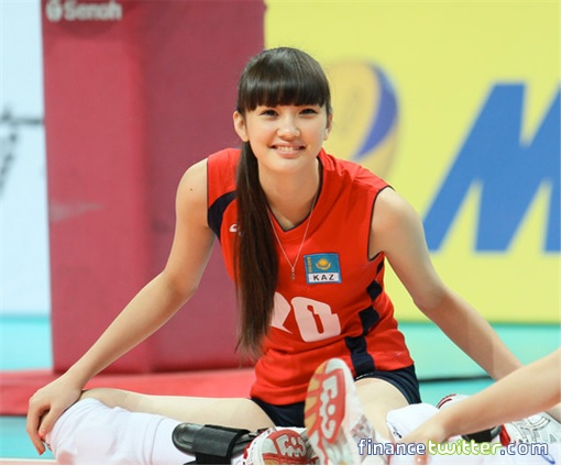 Kazakhstan Sabina Altynbekova - Volleyball Player Babe - warming up sitting on court smiling