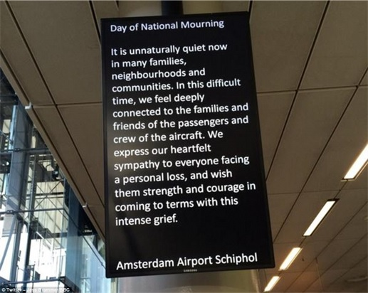 Malaysian Flight MH17 Shot Down - Victims Arrive in Holland - Amsterdam airport mourning notice