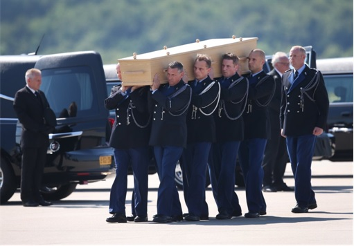 Malaysian Flight MH17 Shot Down - Victims Arrive in Holland - Dutch military personnel carry coffin 2