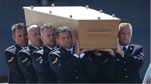 Malaysian Flight MH17 Shot Down - Victims Arrive in Holland - Dutch military personnel carry coffin 3