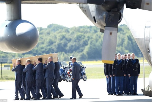 Malaysian Flight MH17 Shot Down - Victims Arrive in Holland - Dutch military personnel carry coffin