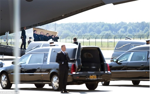 Malaysian Flight MH17 Shot Down - Victims Arrive in Holland - First coffin from Royal Dutch Air Force C130