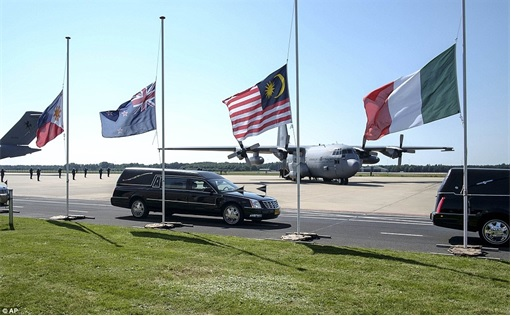 Malaysian Flight MH17 Shot Down - Victims Arrive in Holland - Hearse leaving Eindhoven military airport to Kaporaal van Oudheusden military barracks 2