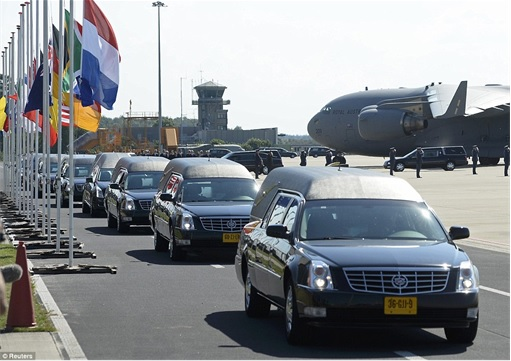 Malaysian Flight MH17 Shot Down - Victims Arrive in Holland - Hearse leaving Eindhoven military airport to Kaporaal van Oudheusden military barracks