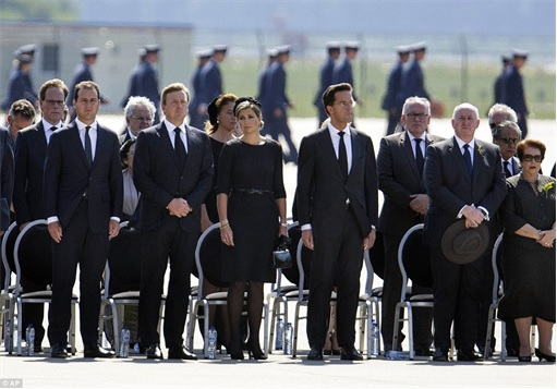 Malaysian Flight MH17 Shot Down - Victims Arrive in Holland - King Willem-Alexander and Queen Maxima standing for respect