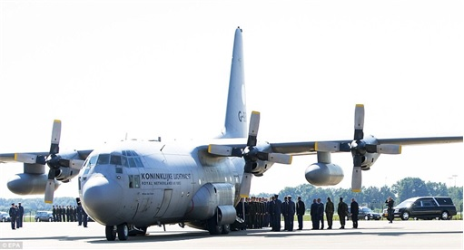 Malaysian Flight MH17 Shot Down - Victims Arrive in Holland - Prepare to take coffins from Royal Dutch Air Force C130