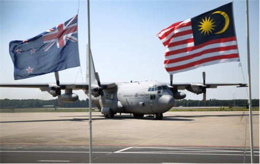 Malaysian Flight MH17 Shot Down - Victims Arrive in Holland - Royal Dutch Air Force C130 plane