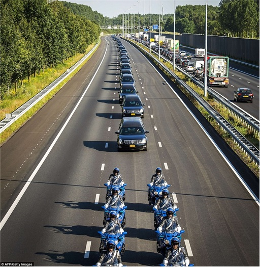 Malaysian Flight MH17 Shot Down - Victims Arrive in Holland - hearses under military police escort
