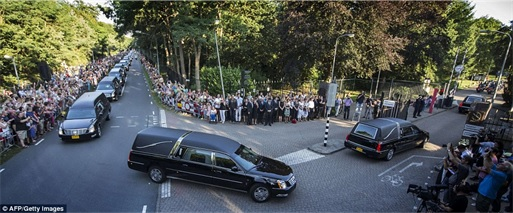 Malaysian Flight MH17 Shot Down - Victims Arrive in Holland - military police escort arriving at army barrack 3