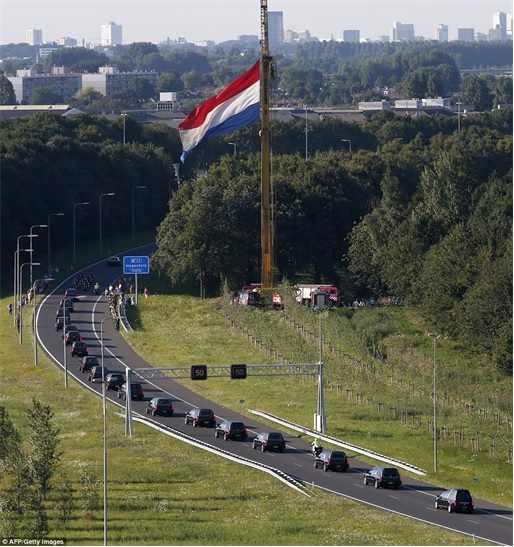 Malaysian Flight MH17 Shot Down - Victims Arrive in Holland - rows of hearses under military police escort 3