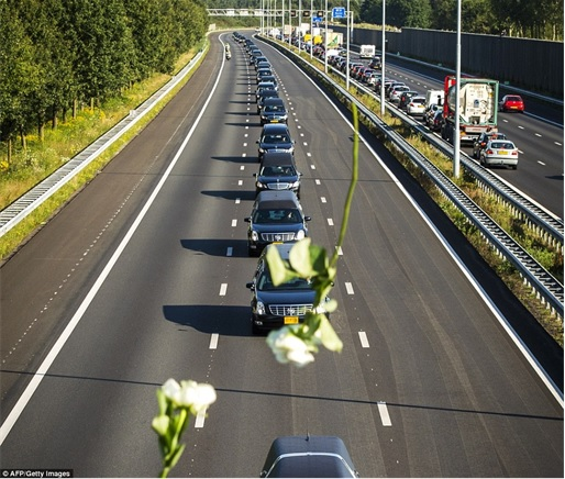 Malaysian Flight MH17 Shot Down - Victims Arrive in Holland - rows of hearses under military police escort
