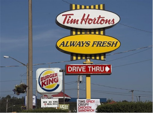 Burger King and Tim Hortons Merger - Signboards on the road