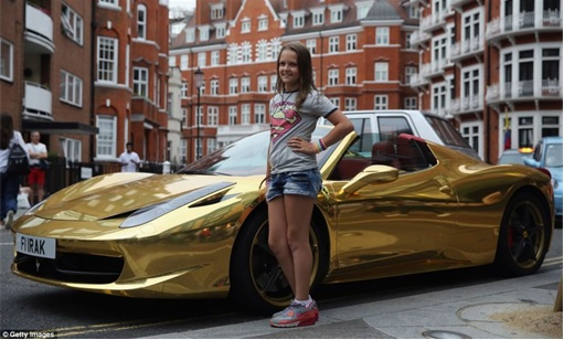 Gold Ferrari 458 Spider - A Girl Taking Photograph