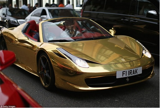 Gold Ferrari 458 Spider FI IRAK- driving along London Kensington and Knightsbridge