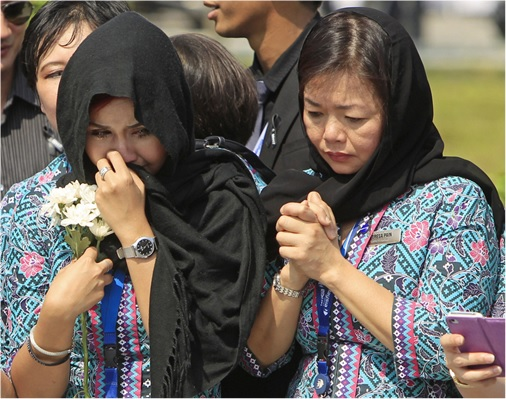 Malaysian Flight MH17 Victims Return Home - MAS crew members cry with sadness