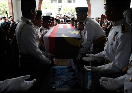Malaysian Flight MH17 Victims Return Home - Malaysia Army personnel receive the body of Dora Sheila Kassim in a local mosque