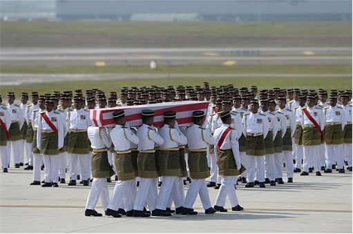 Malaysian Flight MH17 Victims Return Home - Soldiers Carrying Coffin from flight MH6129 - 2