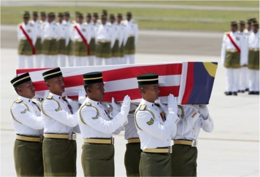 Malaysian Flight MH17 Victims Return Home - Soldiers Carrying Coffin from flight MH6129 - 3