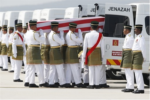 Malaysian Flight MH17 Victims Return Home - Soldiers Carrying Coffin to Hearses