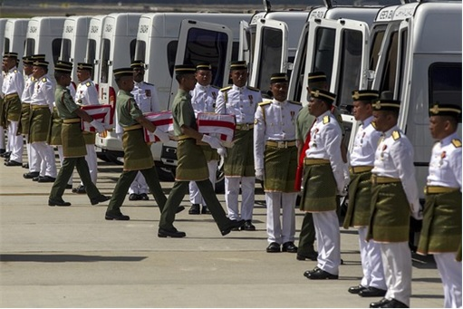 Malaysian Flight MH17 Victims Return Home - Soldiers Carrying Urns to Hearses