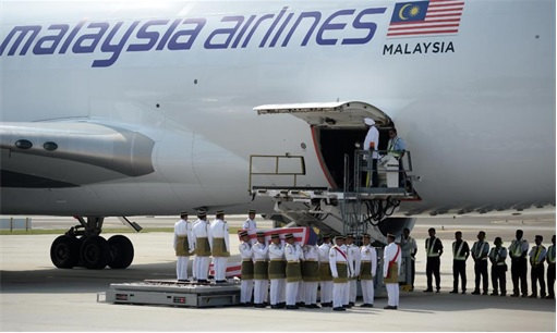 Malaysian Flight MH17 Victims Return Home - Soldiers Started Carrying Coffin from flight MH6129