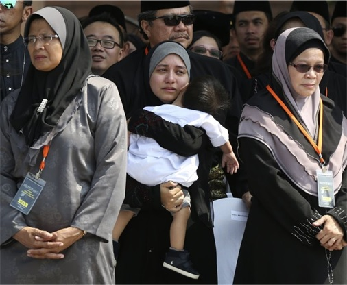 Malaysian Flight MH17 Victims Return Home - Victim's relatives reaction