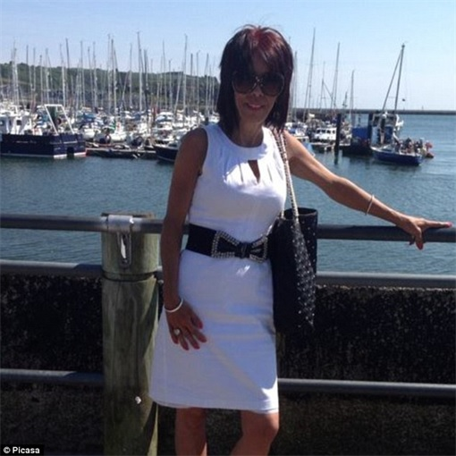 UK Cheating Benefits - Donna Tithecott posing near yacht