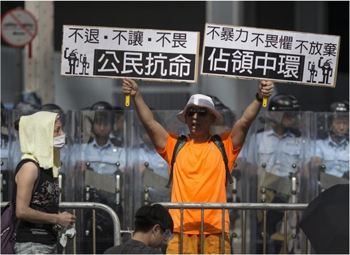 Hong Kong Demonstrations - Man with sign