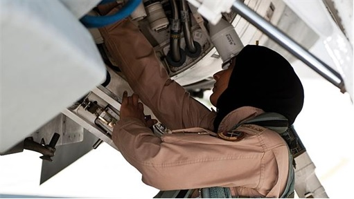 Major Mariam Al Mansouri - checking her fighter jet