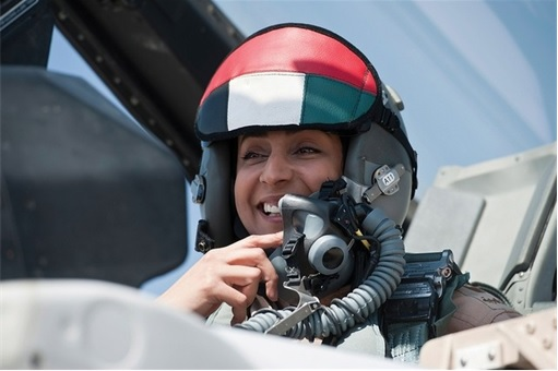 Major Mariam Al Mansouri - in F16 cockpit smiling