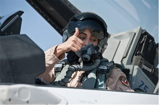 Major Mariam Al Mansouri - in F16 cockpit thumbs up