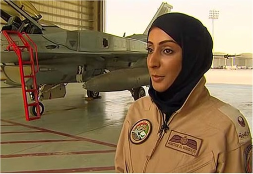 Major Mariam Al Mansouri - talking near her fighter jet