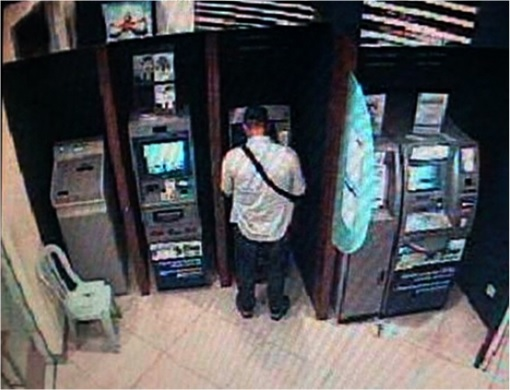 Malaysian ATM Hacked and Robbed - CCTV Shows Hacker