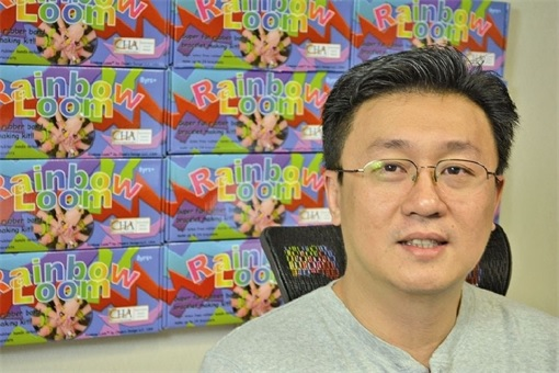 Rainbow Loom Cheong Choon Ng - with loom bands behind him